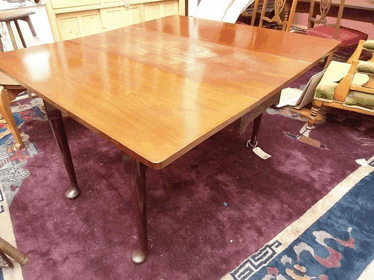 A Geo II drop leaf mahogany table raised on four