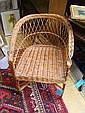A wicker armchair and laundry basket
