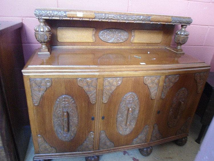 A 1930s oak sideboard
