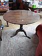 An 18th century oak tilt top tripod table