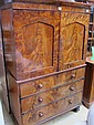 A 19th C. Scottish flame mahogany linen press of