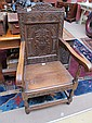 A 19th century oak wainscot arm chair