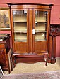 An Edwardian mahogany serpentine display cabinet,