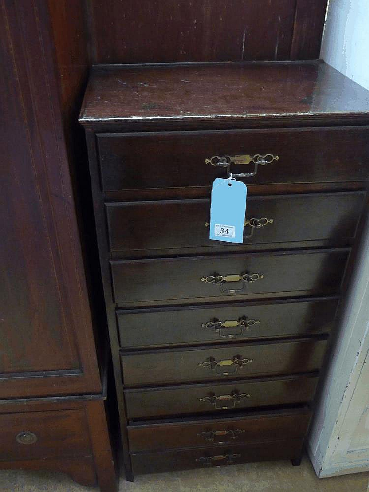 An early 20thC oak tall chest of drawers