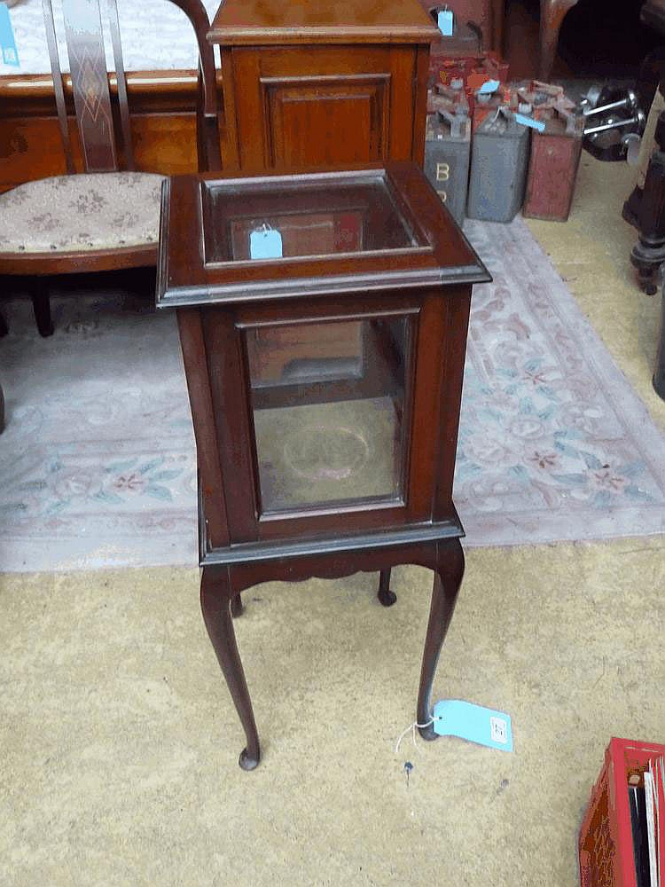 An early 20thC mahogany bijouterie cabinet on legs