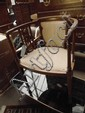 An Edwardian inlaid bedroom armchair with pierced