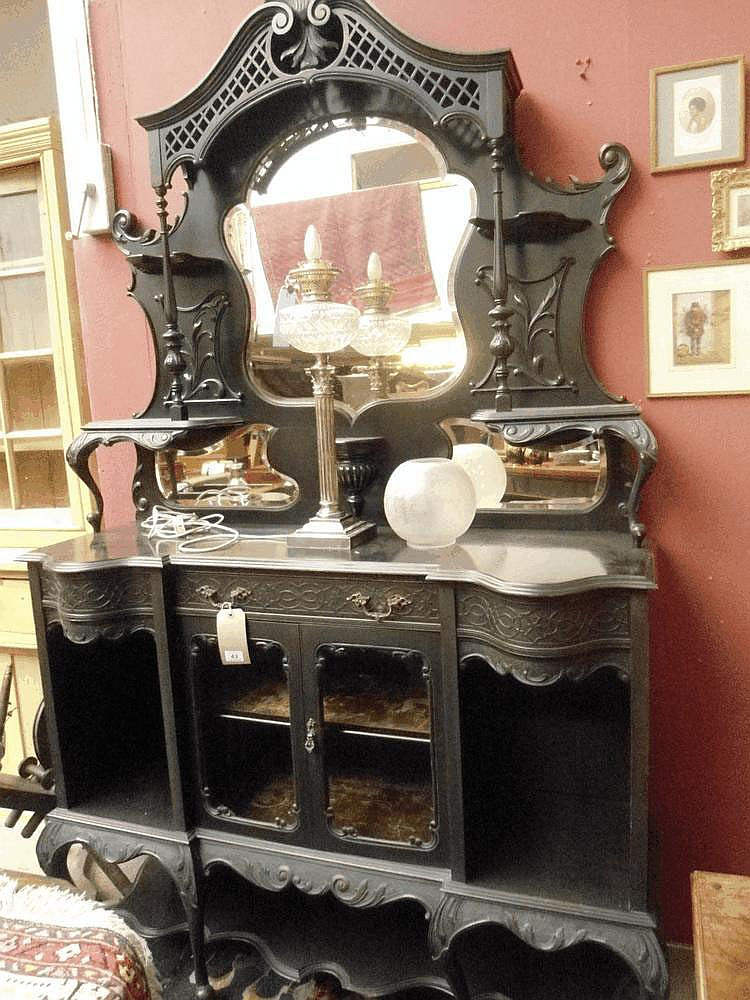 A late 19 centruy ebonised display cabinet.