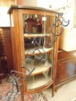 An Edwardian bow fronted display cabinet