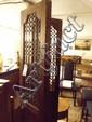 An Indian hardwood & wrought iron three panel room