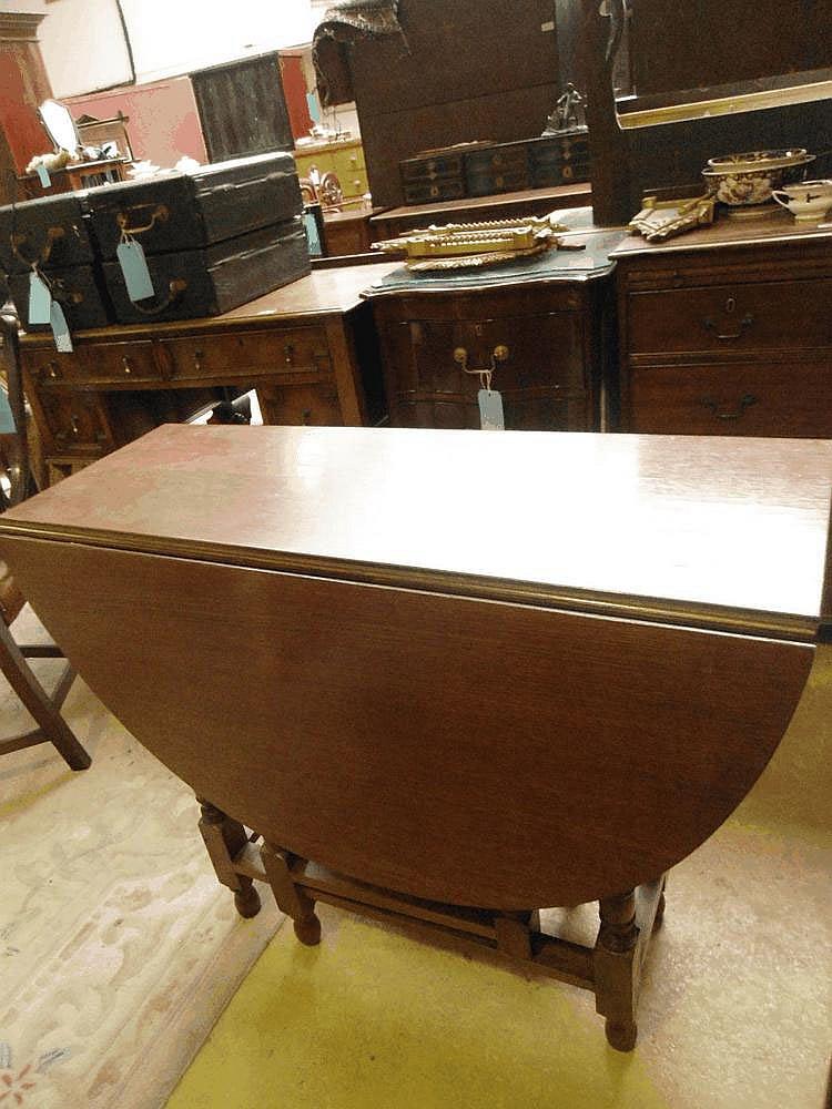 A 1930's oak gateleg table