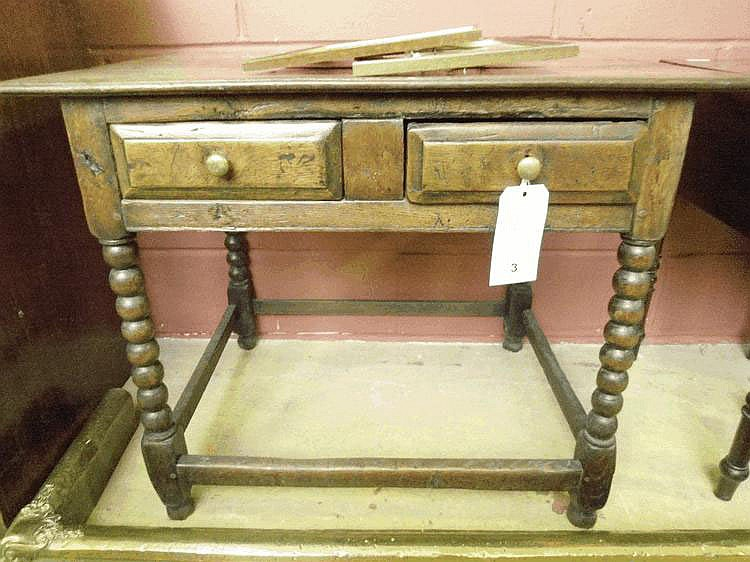 An early 18th century country oak side table with