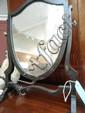 A 20thC skeleton framed mahogany toilet mirror