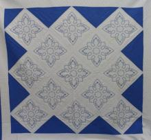 AMERICAN FIRST-HALF 20th-CENTURY STAR OR SNOWFLAKE PATTERN QUILT