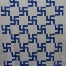 AMERICAN FIRST-HALF 20th-CENTURY HOOKED CROSS (SWASTIKA) PATTERN QUILT