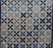 AMERICAN FIRST-HALF 20th-CENTURY WINDMILL AND PATCHWORK PATTERN QUILT
