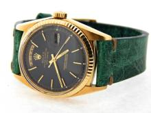 PRE OWNED MENS ROLEX YELLOW GOLD DAY-DATE WITH A BLACK DIAL 1803