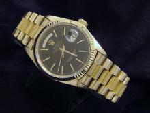 PRE OWNED MENS ROLEX YELLOW GOLD DAY-DATE WITH A BLACK DIAL 18038