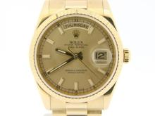 PRE OWNED MENS ROLEX YELLOW GOLD DAY-DATE WITH A GOLD/CHAMPAGNE DIAL 118238