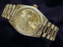 PRE OWNED MENS ROLEX YELLOW GOLD DAY-DATE WITH A GOLD/CHAMPAGNE DIAL 1803