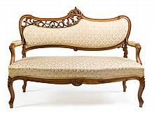 A walnut settee, Late 19th Century,