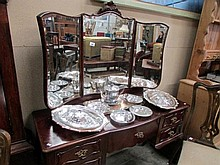 A mahogany dressing table with triple mirror