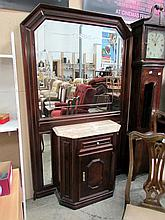 A mahogany marble top cabinet with large overmirror
