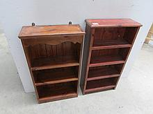 2 stained pine book shelves