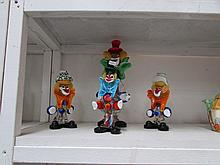 4 coloured glass clowns