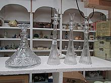 A ship's decanter and 3 glass candleholders
