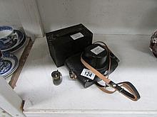 A Zorki camera, case and lens, A vintage Leitz brass film holder and a Port
