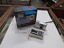 A Polaroid D610 camera, and Ipad Nano and a Pentax Optio 550 camera
