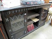 An oak book case with leaded glazed doors