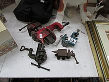 3 small bench vices and a miniature bench anvil