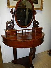 A Victorian mahogany duchy dressing table
