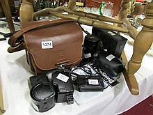 5 camera lenses. flash guns, filters etc