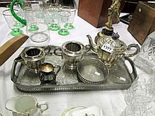 A silver plate tea set on tray