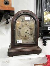 A domed top mahogany mantel clock