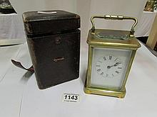 A cased Victorian  brass carriage clock