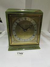 An onyx mantel clock by Elliot