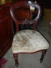 A Victorian mahogany balloon back chair