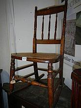 A cane seated rocking chair
