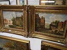 A pair of Gilt framed oil on board street scenes by L Clayton
