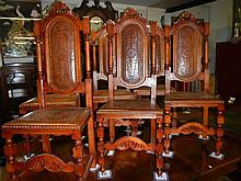 A set of 4 chairs with tooled leather seats and backs