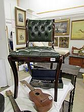 A mahogany chair with leather upholstery