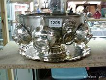 A silver plated punch bowl and 6 cups