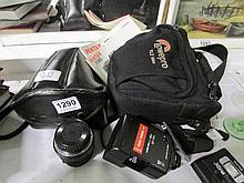 A Pentax P3ON camera, case, 2 lenses, flashgun and a Pentax MZ-5N SLR camer