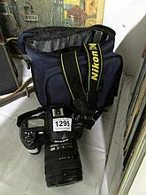 A Nikon D100 camera, case and lens