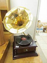 A horn gramaphone with brass horn