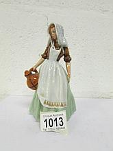 A Royal Doulton figurine, HN2057, 'Milk Maid'