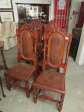A set of 6 dining chairs with tooled leather seats and backs